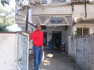 Prasad at the house where he was born.