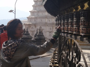 Su-san spins the prayer wheels.