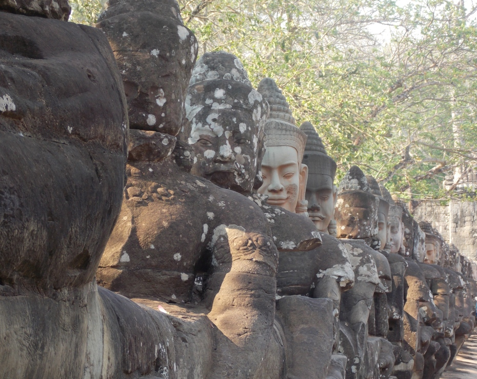 The entrance to Angkor is lined with gods and demons.