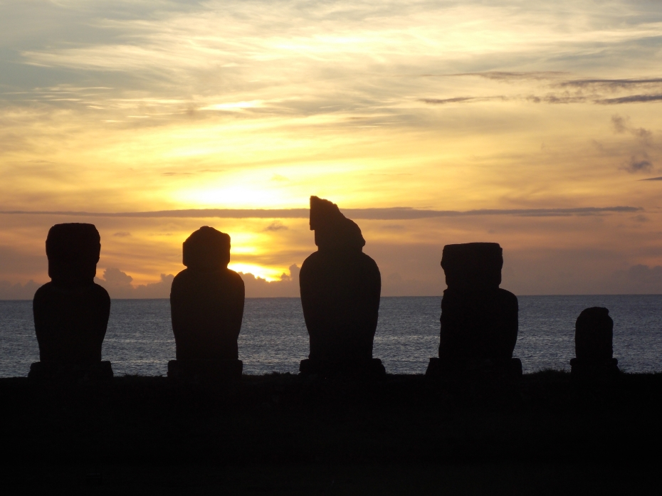 Recognize the fourth guy from the left? We didn't know that when he was phoning home, home was really Easter Island. Cheers!