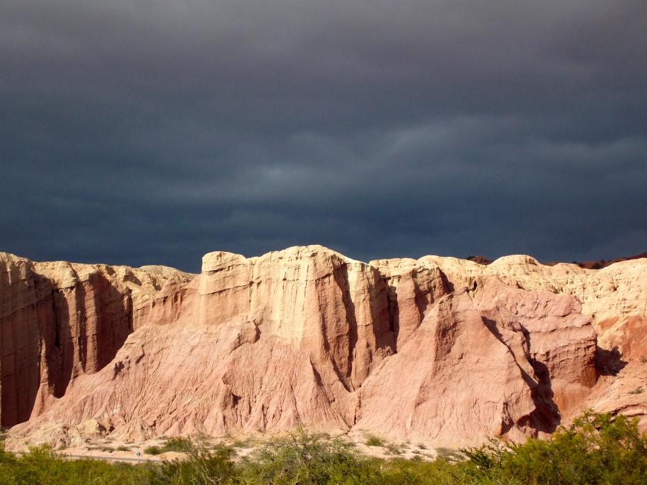 Sun on the cliffs, ominous sky.
